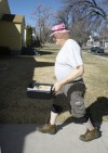 Ken Peterson delivers a meal for Meals on Wheels