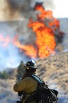 Fire fighters battle a range and timber fire along Highway 87