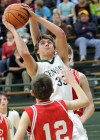 Central's Dylan Hanser, 33, puts up a shot