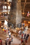 Visitors admire the spectacular log architecture of Old Faithful Inn