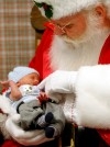 Santa holds five-day-old Chase McHenry