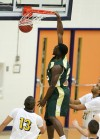 John Bayo of Rocky Mountain College dunks