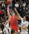 Senior's Brennan Nielsen, 44, puts up a shot as Central's Jacob Stanton, 2, and Daniel Meyer, 32, defend