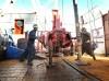 Oil rig workers make a pipe change on a Bakken field rig