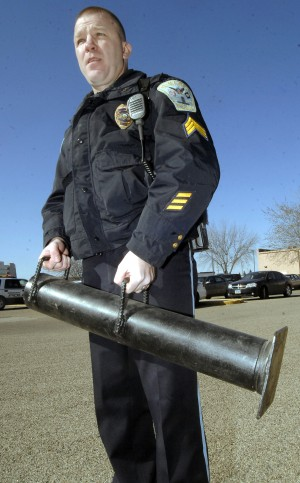 Battering Ram Police holds a battering ram to