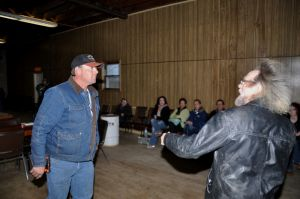 White supremacist Craig Cobb, right, had a brief face-off with a member of the Standing Rock Sioux tribe prior to the Leith City Council meeting Sunday night, Oct. 27, 2013.