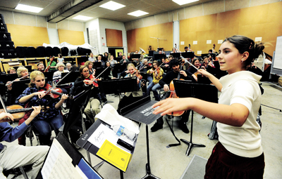 Fifth grader Meryl Pawlick takes up the baton to conduct Bozeman Symphony