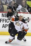 Pittsburgh Penguins' Sidney Crosby (87) collides with Anaheim Ducks' Ryan Getzlaf (15) during the first period of an NHL hockey game in Pittsburgh, Monday, Feb. 8, 2016. (AP Photo/Gene J. Puskar)