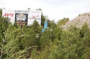 Aircraft crashes into trees off U.S. 65