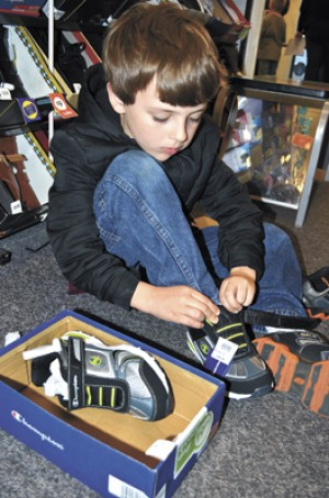 Grant Helps Put New Shoes On Kids News Brenham Banner