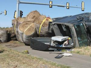 Busted brakes lead to hay bale spill