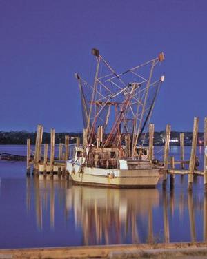 Shrimp boat at night