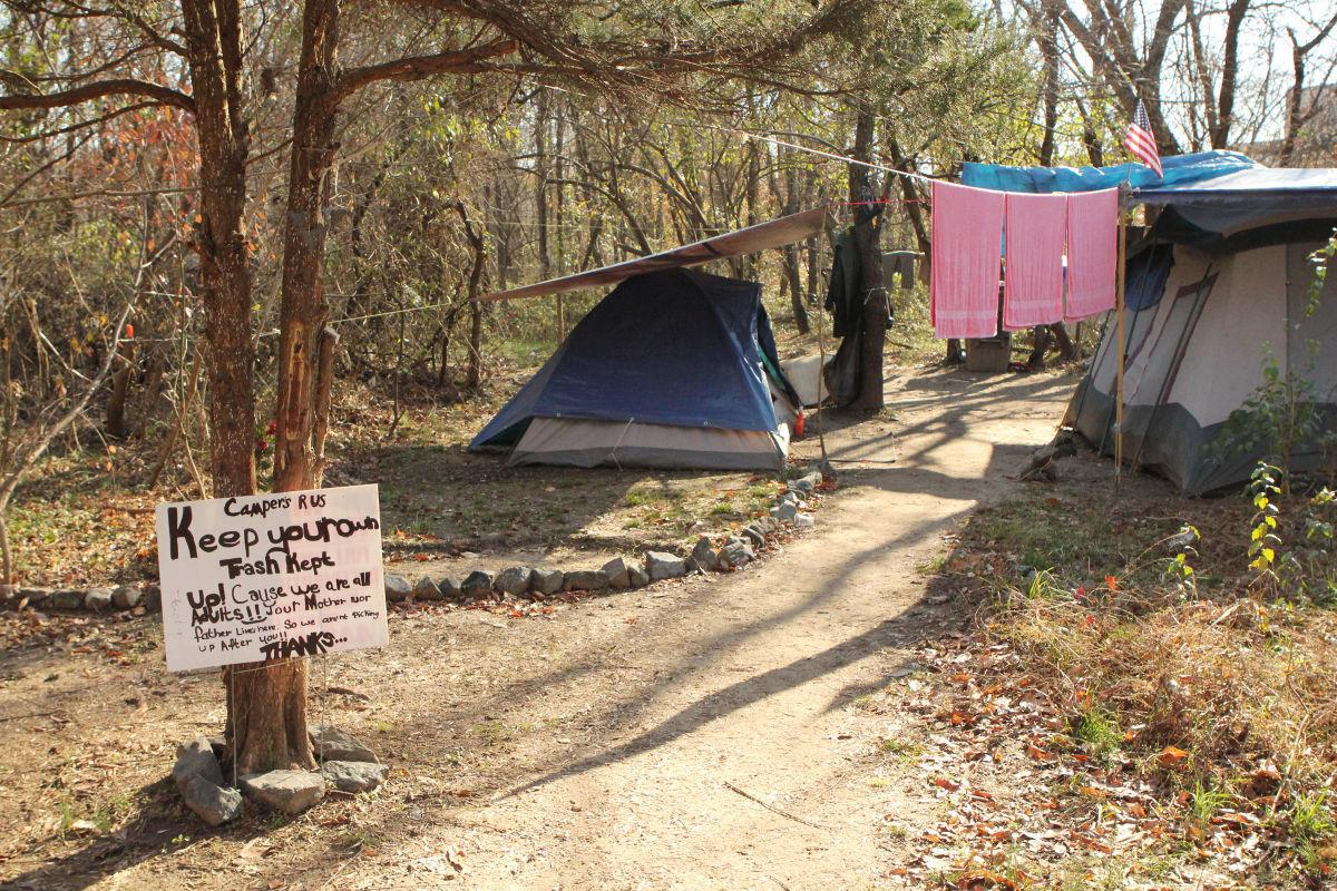 One of the camp setups behind the big elk mall features a sign warning