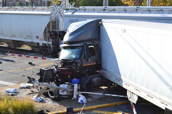 Tractor-trailer driver still in critical condition after collision ...