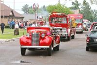 "<p>The funeral procession for Douglas ""Duggy"" Nelson, a longtime officer and firefighter, leaves the Chetek United Methodist Church on Saturday, June 20. The procession, escorted by an assortment of emergency vehicles, carried Nelson's casket on the Chetek Fire Department's restored 1940 fire engine, above. Pictured driving is Fire Chief Al Zeltner with former Fire Chief Joe Atwood in the passenger seat.</p>"