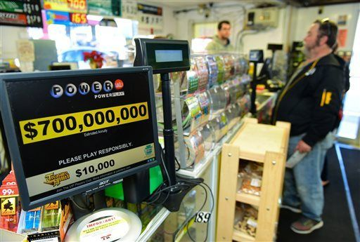 Powerball jackpot jumps to $900 million hours before drawing