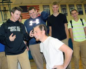Macks' win costs chaplain his hair