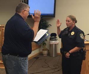 <p>Ashville Mayor Chuck Wise swears in Sarah Hempstead, Ashville's newest police officer, at the village council meeting Tuesday.</p>
