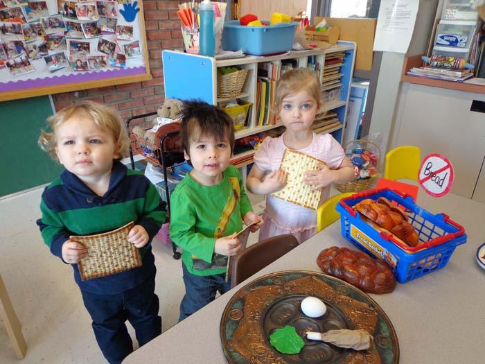 Erik Sandor, Eli Smith and Emmaline Rosenberg learn about the seder at Ganon Gil Preschool.