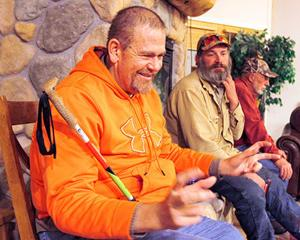"<p class=""p1""><strong>Lew Harper of Idaho Falls talks about harvesting a big buck on the final day of a hunt organized by the Wyoming Disabled Hunters Organization as his volunteer companion guide Vince Mccollam of Byron looks on during a final get-together of disabled hunters on Nov. 4.</strong></p>"