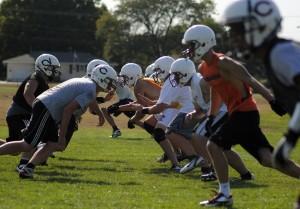 City football teams get to work
