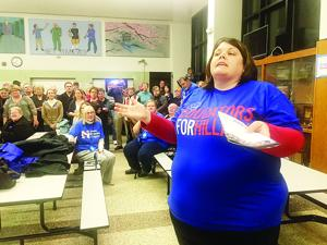 <p>Allison Rasmussen makes the case for former Secretary of State Hillary Clinton during the Waverly Ward 4 Democratic caucus in the Waverly-Shell Rock High School cafeteria on Monday, Feb. 1, 2016.</p>