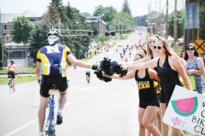 <p>W-SR Dance Team members cheered for the RAGBRAI riders as they rolled into Waverly.</p>