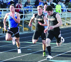 <p>Waverly-Shell Rock's Brandt Seward, far right, gets ready to cross the finish line in first place during the 100-meter dash at the Dave Sage Relay on Friday. Also pictured is Peter Bates, middle.</p>