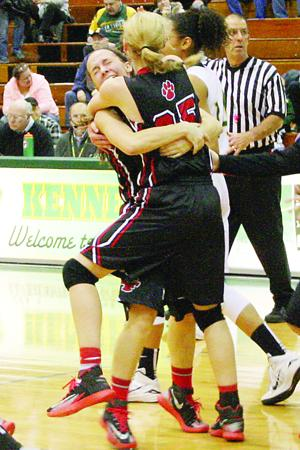 <p>Cedar Falls' Jamie Becker and Ally Conrad hug after Conrad hit the eventual game-winning lay-up with 0.9 second left to play to give the Tigers a 51-49 victory over Cedar Rapids Kennedy in the Class 5A Region 8 final on Tuesday, Feb. 24, 2015, in the Kennedy High School gymnasium.</p>
