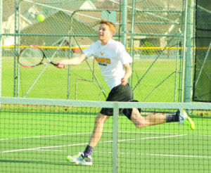 <p>Waverly-Shell Rock's Brad Wylam gets to a ball during Tuesday's match against Aplington-Parkersburg at the W-SR tennis courts.</p>