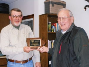 <p>Frank Frederick, director of the Bremer County Conservation Board, presents Don Freeman with an honorary plaque for his years of service.</p>