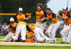 <p>The Waverly-Shell Rock baseball team piles on Sean Westendorf after the Go-Hawks beat West Delaware 2-0 Wednesday in Oelwein in a Class 3A substate game.</p>