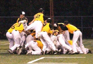 <p>Waverly-Shell Rock dogpiles on Sky Holmgren (at the bottom of the pile) after he drove in the winning run against Decorah on Monday in the Class 3A district final game at Hertel Field.</p>