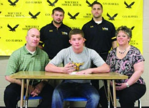 <p>Waverly-Shell Rock's Corey Abernathy, front middle, signs his national letter of intent to wrestle for Minnesota State Mankato. Also pictured, in front, are his dad, Mark, and mother, Tami. In back are W-SR head wrestling coach Eric Whitcome and W-SR assistant coach Cody Pierce.</p>