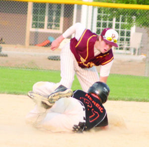 <p>Denver's Justin Gray tags out Tripoli's Zach Hereid on a pickoff play at second base during Thursday's district game in Denver.</p>