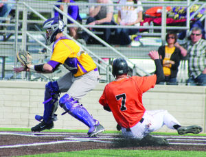 <p>Wartburg's Ryan Powers (23) tags out a Loras runner who picked off at second base during Saturday's doubleheader at Hertel Field.</p>
