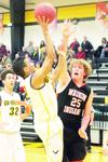 Waverly-Shell Rock's Camry Moore (2) fades away to avoid a block attempt by Waukon's Brock Waters (25) during the Go-Hawks' 64-48 victory over the Indians on Tuesday, Dec. 16, 2014, at the W-SR gymnasium.