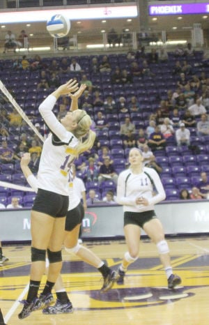 <p>UNI outside hitter Eryca Hingtgen gets ready to set up the offense after a block during a match against Wisconsin-Green Bay last season.</p>