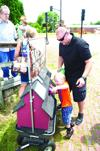 Mike Zimmerly helps Dexter put pennies in the donation box.