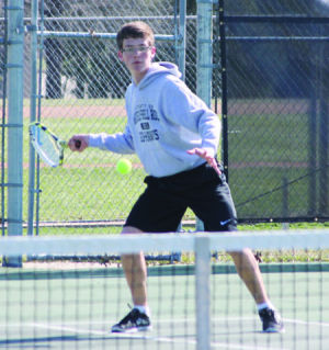 <p>Waverly-Shell Rock's Jack Behrens winds up for a shot during Tuesday's home match against Dike-New Hartford.</p>