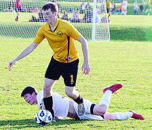 <p>Waverly-Shell Rock defender Kaleb Cormick (1) heads up field after winning the ball away from Cedar Falls' Christopher Keys during the first half of the Go-Hawks' 3-0 victory over the Tigers at the Cedar Valley Soccer Complex on Monday, April 21, 2014.</p>