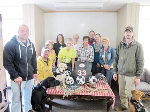 <p>The Bartels Lutheran Retirement Community first floor nursing staff hosted a benefit pot luck on April 17 to benefit Retrieving Freedom Inc. Some of the staff posed with representatives and dogs from RFI during the event. Similar pot lucks have also benefitted the Waverly Fire Department, Northeast Iowa Food Bank and American Heart Association.</p>