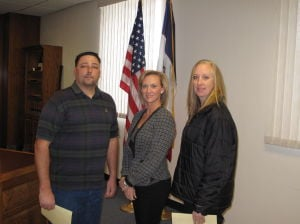 <p>Oelwein's new Mayor Jason Manus (left) and new council member Renee Cantrell (right) were officially sworn in this week by City Administrator Jamie Letzring. </p>