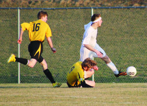 <p>Waverly-Shell Rock's Bradyn Flaig gets tripped up as he makes a run toward the goal. Flaig would later score on a penalty kick during Thursday's home opener against Clear Lake.</p>