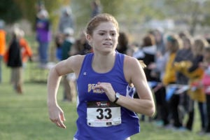 <p>Senior Victoria Bartelt pictured running in the WAMAC Conference meet held at Center Point-Urbana High School was the first Bobcat to cross the finish line finishing 41st with a time of 16:49. At Districts she finished  40th with a time of 17:01.</p>