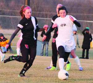 <p>Waverly-Shell Rock's Skylin Heidemann gets past a couple of Union players during Tuesday's home win.</p>