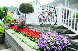 <p>Businesses and homes are decorated with bikes to welcome the riders and set the tone for July 24.</p>