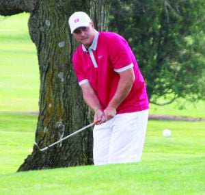 <p>Dave Grawe chips over a hill on hole No. 2 at the Waverly Golf and Country Club during Saturday's city championship. Grawe won the title in a playoff. For more photos, see page A13</p>