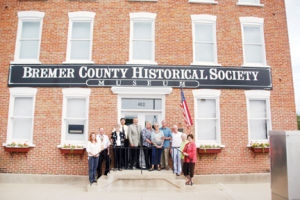 <p>The Bremer County Historical Soceity hosted county officials and Waverly Mayor Chuck Infelt to tour the museum at 402 W. Bremer Ave. to help spread the word about it and to encourage people to view it. Pictured on the front steps are, from left, County Auditor Shelley Wolf, Supervisor Ken Kammeyer, historical society board member Ann Masterpole, Supervisors Tim Neil and Dewey Hildebradt, county financial director Kassandra Johansen, Lou and Chuck Infelt, and historical society board members Tom Baker, Cordella Gaede and Jan Heidemann.</p>