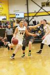 Waverly-Shell Rock junior Kelsey Young (14) dribbles toward the lane with Charles City sophomore Payton Reams (11) defending on Tuesday, Feb. 9, 2016 in Go-Hawk gymnasium. Young finished with 7 points in the Go-Hawks' 65-26 win over the Comets in the regular-season finale.